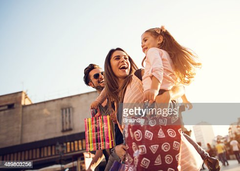 Below view of young cheerful family in shopping.