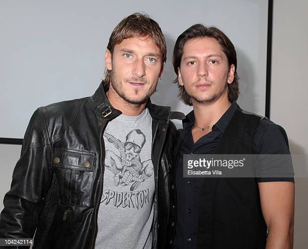 Belstaff's Michele Malenotti and Francesco Totti attend the Belstaff Official Meeting with AS Roma football player at the AS Roma headquarters...