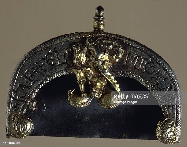 Belt chape early 16th century This silvergilt protective covering for a belt end is decorated with a figure of St Barbara the patron saint of...