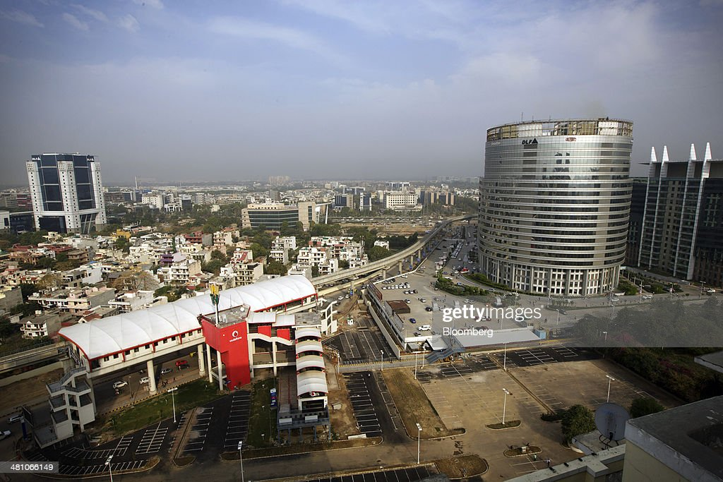Belvedere Towers metro station, left, operated by Rapid MetroRail Gurgaon Ltd., stands next to DLF Cybercity, a 128 acre integrated business district, in Gurgaon, India, on Wednesday, March 26, 2014. Indian stocks rose, sending the benchmark index to a record, after the rupee rose to an eight-month high and sovereign bonds gained on speculation the worlds largest democracy will elect a government capable of reviving economic growth. Photographer: Kuni Takahashi/Bloomberg via Getty Images
