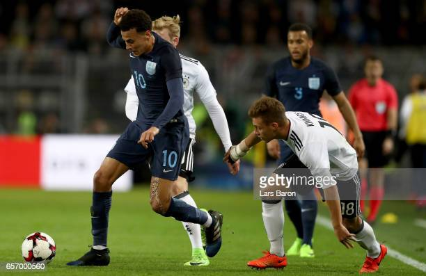 Bemidele Alli of England is challenged by Joshua Kimmich of Germany during the international friendly match between Germany and England at Signal...