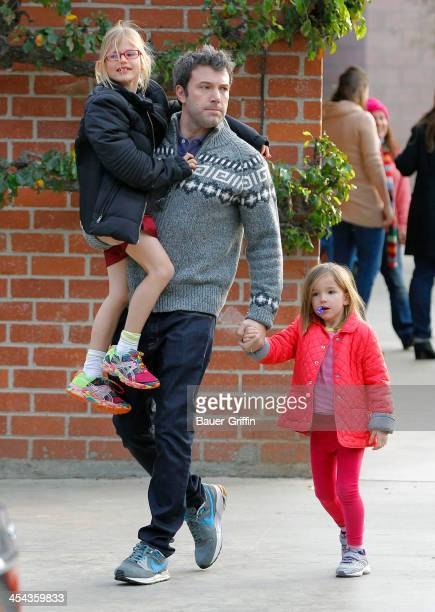 Ben Affleck and his daughters Violet and Seraphina Affleck are seen leaving the park on December 08 2013 in Los Angeles California
