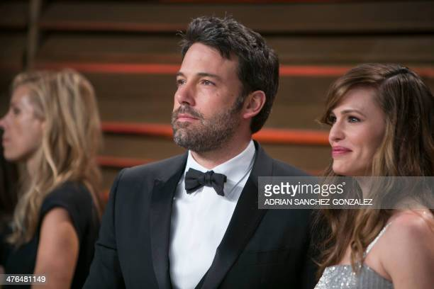 Ben Affleck and Jennifer Garner arrive at the 2014 Vanity Fair Oscar Party on March 2 2014 in West Hollywood California AFP PHOTO/ADRIAN...