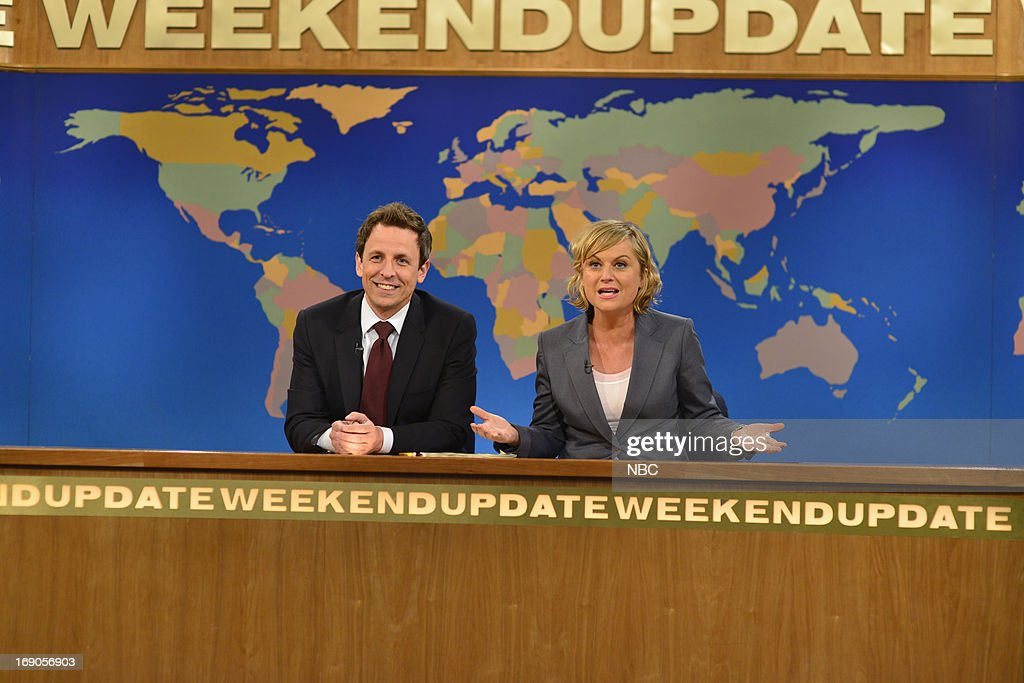 LIVE -- 'Ben Affleck' Episode 1641 -- Pictured: (l-r) Seth Meyers and Amy Poehler during Weekend Update on May 18, 2013 --