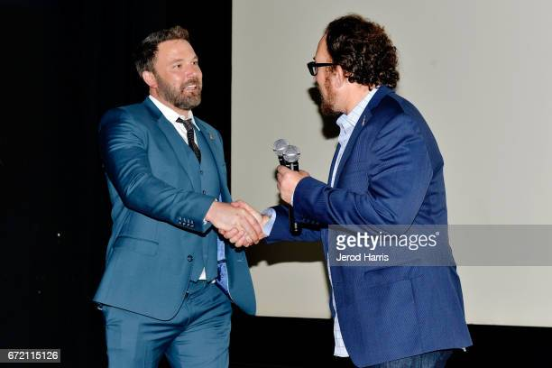 Ben Affleck shakes Matthew Asner's hand on stage at the 1st Annual AutFest International Film Festival at AMC Orange 30 on April 23 2017 in Orange...