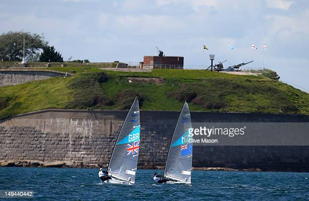 Ben Ainslie of Great Britain and Dan Slater of New Zealand in action during a Finn Class practice race at the Weymouth Portland Venue during the...