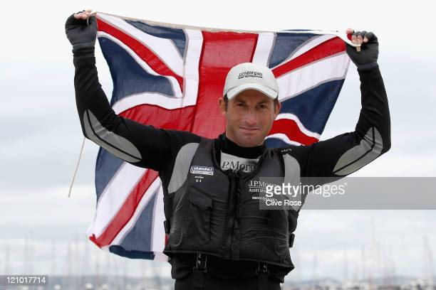 Ben Ainslie of Great Britain celebrates on shore after winning the Mens Finn class medal race on day twelve of the Weymouth and Portland...
