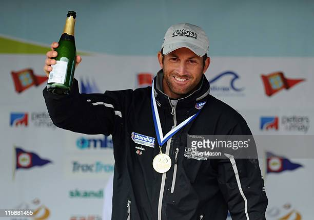 Ben Ainslie of Great Britain celebrates with his gold medal in the Finn class medal race on day six of the Skandia Sail for Gold Regatta at the...