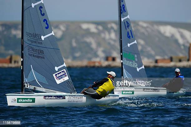 Ben Ainslie of Great Britain in action ahead of team mate Giles Scott of Great Britain on his way to a gold medal in the Finn class medal race on day...