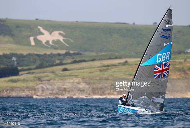 Ben Ainslie of Great Britain in action during a Finn Class practice race at the Weymouth Portland Venue during the London 2012 Olympic Games on July...
