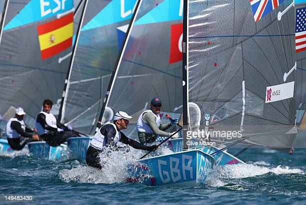Ben Ainslie of Great Britain in action during the first Finn Class race of the London 2012 Olympic Games at the Weymouth Portland Venue at Weymouth...