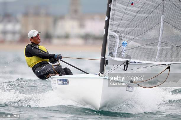 Ben Ainslie of Great Britain in action on his way to a gold medal in the Finn Class medal race on day twelve of the Weymouth and Portland...