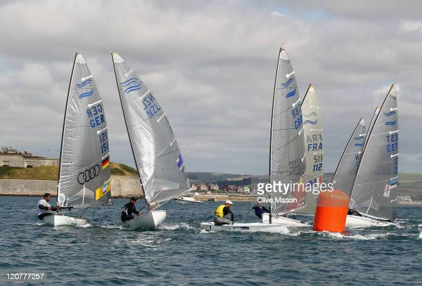 Ben Ainslie of Great Britain rounds the top mark during a Finn Class race on day nine of the Weymouth and Portland International Regatta at the...