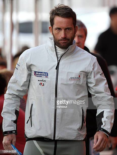 Ben Ainslie of Great Britain walks thru Fishing Boat Harbour on day 8 after completing the Finn gold fleet race of the 2011 ISAF Sailing World...