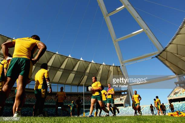 Ben Alexander of the Wallabies runs the ball during an Australian Wallabies training session at the Moses Mabhida Stadium on August 10 2011 in Durban...