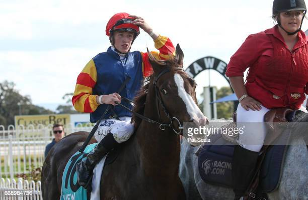 Ben Allen returns to the mounting yard on Plus Effronte after winning Stawell Glass Maiden Plate at Stawell Racecourse on April 16 2017 in Stawell...