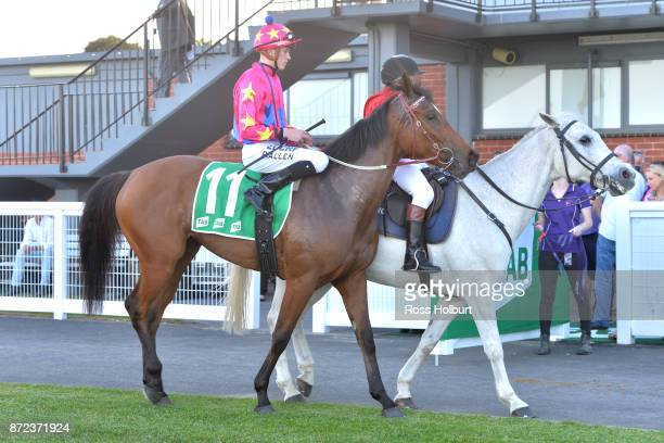 Ben Allen returns to the mounting yard on Zoey Lass after winning the Obrien Real Estate FM Maiden Plate at Cranbourne Racecourse on November 10 2017...