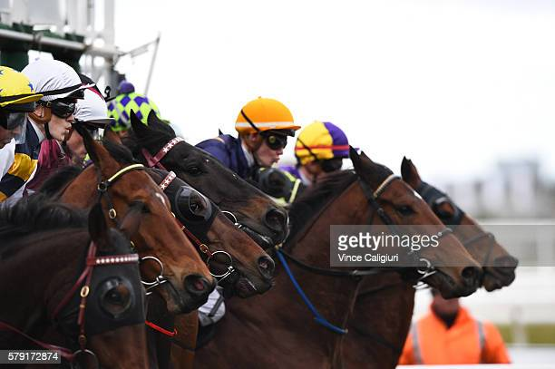Ben Allen riding Au Revoir jumps out of barriers before winning Race 7 during Melbourne Racing at Flemington Racecourse on July 23 2016 in Melbourne...