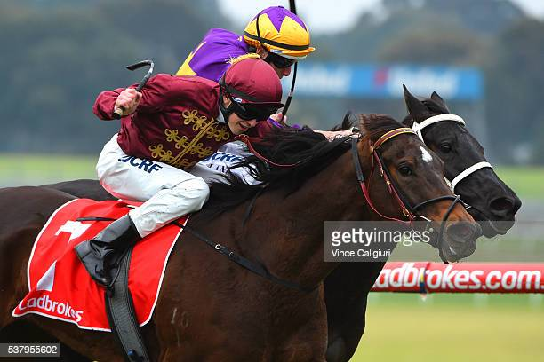 Ben Allen riding Clemency defeats Damian Lane riding Niminypiminy during Melbourne racing at Sandown Lakeside on June 4 2016 in Melbourne Australia