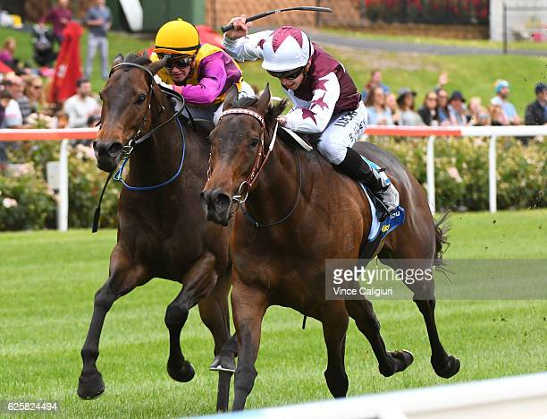 Ben Allen riding Lyuba defeats Jake Bayliss riding Chiavari in Race 3 during Melbourne racing at Moonee Valley Racecourse on November 26 2016 in...