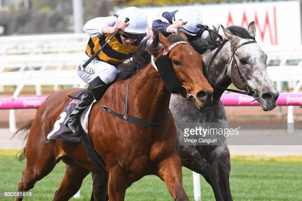Ben Allen riding Master Zephyr defeats Beau Mertens riding Kilimanjaro in Race 2 during Melbourne Racing at Flemington Racecourse on August 12 2017...