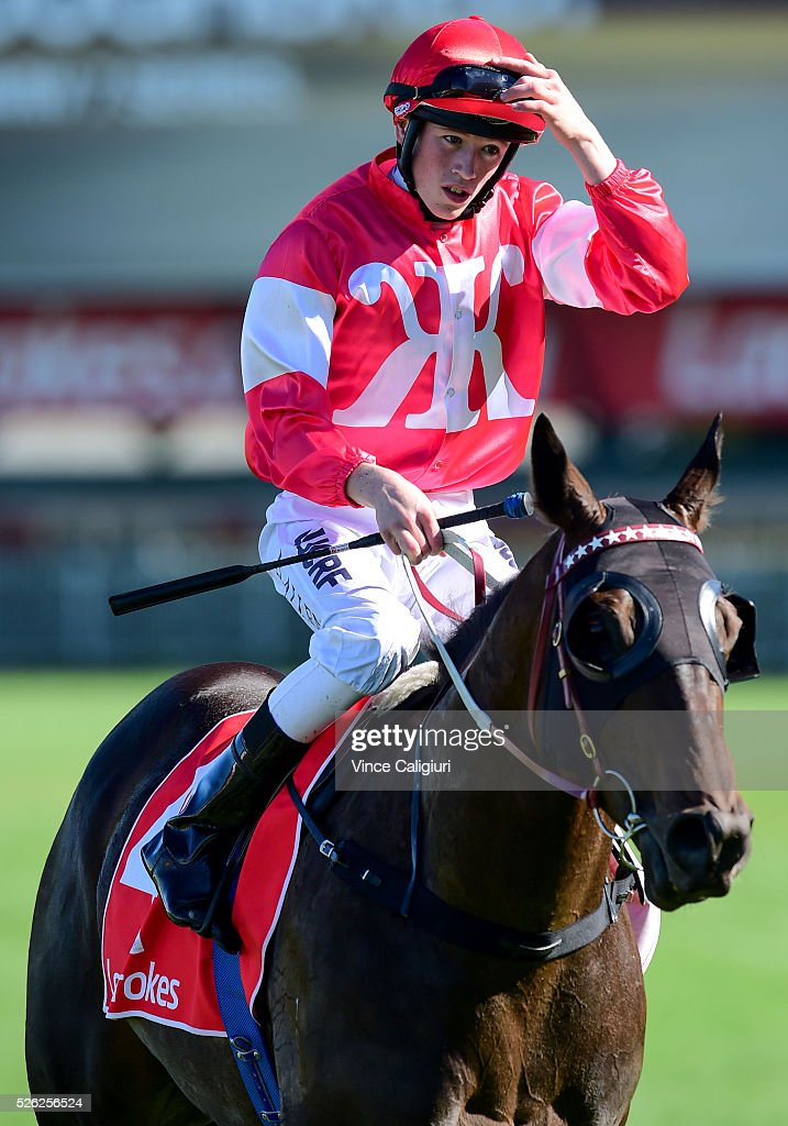Ben Allen riding Olivier after winning Race 3, during Melbourne Racing at Caulfield Racecourse on April 30, 2016 in Melbourne, Australia.