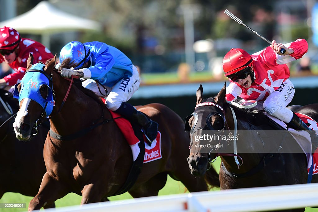 Ben Allen riding Olivier (r) defeats Nick Hall riding Coram in Race 3, during Melbourne Racing at Caulfield Racecourse on April 30, 2016 in Melbourne, Australia.
