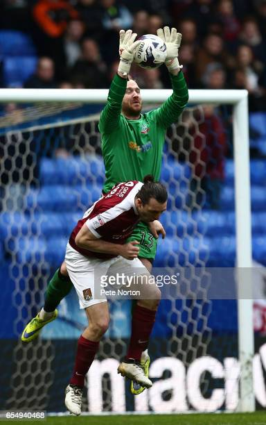 Ben Alnwick of Bolton Wanderers collects the ball under pressure from JohnJoe O'Toole of Northampton Town during the Sky Bet League One match between...