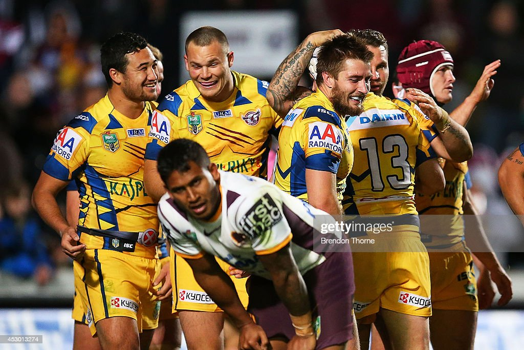 <a gi-track='captionPersonalityLinkClicked' href=/galleries/search?phrase=Ben+Barba&family=editorial&specificpeople=5476664 ng-click='$event.stopPropagation()'>Ben Barba</a> of the Broncos shows signs of dejection while <a gi-track='captionPersonalityLinkClicked' href=/galleries/search?phrase=Brett+Stewart&family=editorial&specificpeople=220234 ng-click='$event.stopPropagation()'>Brett Stewart</a> of the Sea Eagles celebrates with team mates after scoring a try during the round 21 NRL match between the Manly-Warringah Sea Eagles and the Brisbane Broncos at Brookvale Oval on August 1, 2014 in Sydney, Australia.