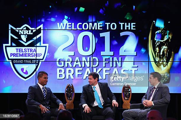 Ben Barba of the Bulldogs and Billy Slater of the Storm are interviewed by Matt Johns during the 2012 NRL Grand Final breakfast at Doltone House on...