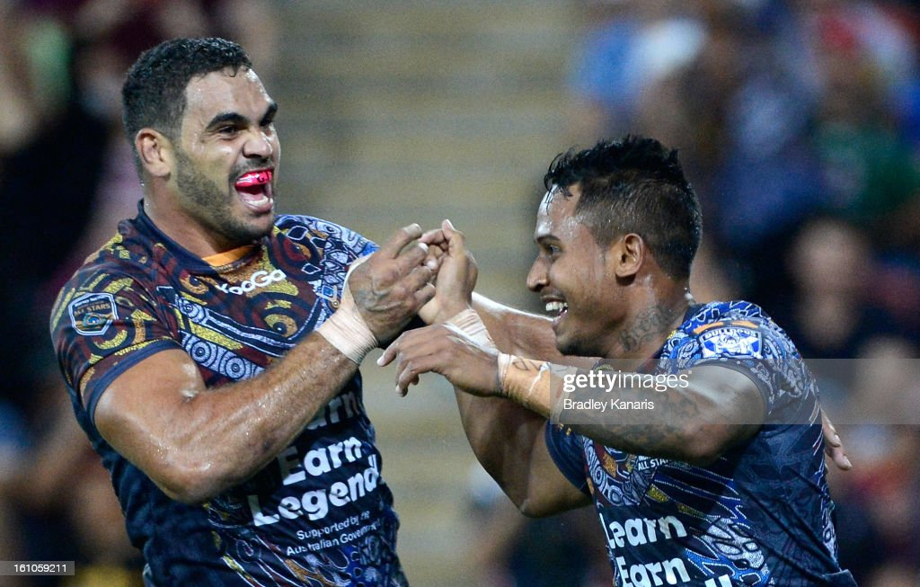 <a gi-track='captionPersonalityLinkClicked' href=/galleries/search?phrase=Ben+Barba&family=editorial&specificpeople=5476664 ng-click='$event.stopPropagation()'>Ben Barba</a> (R) of the Indigenous All Stars celebrates with team mate <a gi-track='captionPersonalityLinkClicked' href=/galleries/search?phrase=Greg+Inglis&family=editorial&specificpeople=597192 ng-click='$event.stopPropagation()'>Greg Inglis</a> after scoring a try during the NRL All Stars Game between the Indigenous All Stars and the NRL All Stars at Suncorp Stadium on February 9, 2013 in Brisbane, Australia.