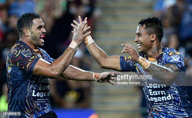 Ben Barba of the Indigenous All Stars celebrates with team mate Greg Inglis after scoring a try during the NRL All Stars Game between the Indigenous...