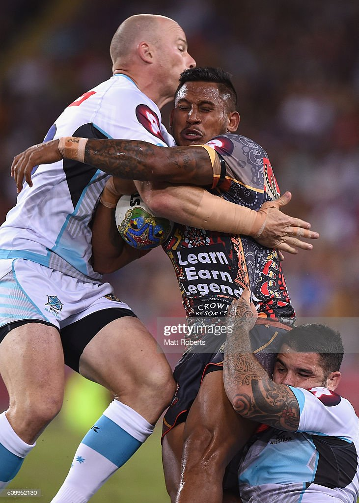 <a gi-track='captionPersonalityLinkClicked' href=/galleries/search?phrase=Ben+Barba&family=editorial&specificpeople=5476664 ng-click='$event.stopPropagation()'>Ben Barba</a> of the Indigenous All Stars is tackled by <a gi-track='captionPersonalityLinkClicked' href=/galleries/search?phrase=Beau+Scott&family=editorial&specificpeople=625951 ng-click='$event.stopPropagation()'>Beau Scott</a> and <a gi-track='captionPersonalityLinkClicked' href=/galleries/search?phrase=Adam+Reynolds+-+Rugbyspieler&family=editorial&specificpeople=12886494 ng-click='$event.stopPropagation()'>Adam Reynolds</a> of the World All Stars during the NRL match between the Indigenous All-Stars and the World All-Stars at Suncorp Stadium on February 13, 2016 in Brisbane, Australia.