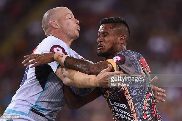 Ben Barba of the Indigenous All Stars is tackled by Beau Scott of the World All Stars during the NRL match between the Indigenous AllStars and the...