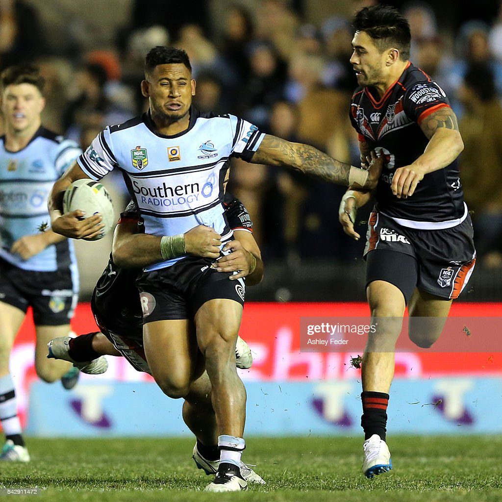 <a gi-track='captionPersonalityLinkClicked' href=/galleries/search?phrase=Ben+Barba&family=editorial&specificpeople=5476664 ng-click='$event.stopPropagation()'>Ben Barba</a> of the Sharks is tackled by Shaun Johnson of the Warriors during the round 16 NRL match between the Cronulla Sharks and the New Zealand Warriors at Southern Cross Group Stadium on June 25, 2016 in Sydney, Australia.