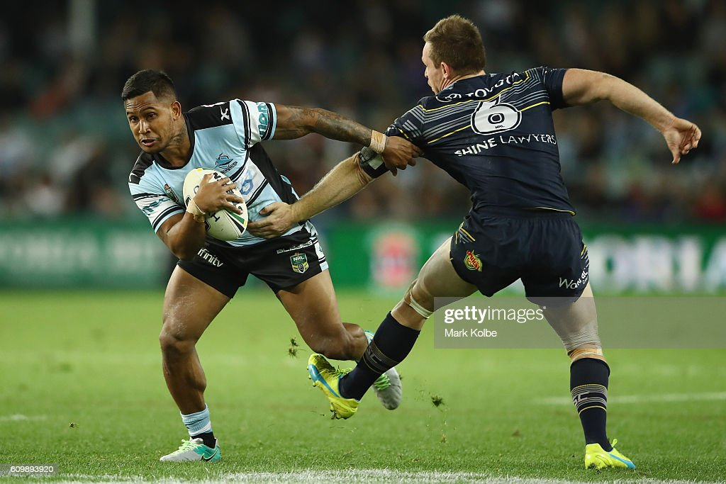 Ben Barba of the Sharks steps around the tackle of Michael Morgan of the Cowbys during the NRL Preliminary Final match between the Cronulla Sharks and the North Queensland Cowboys at Allianz Stadium on September 23, 2016 in Sydney, Australia.
