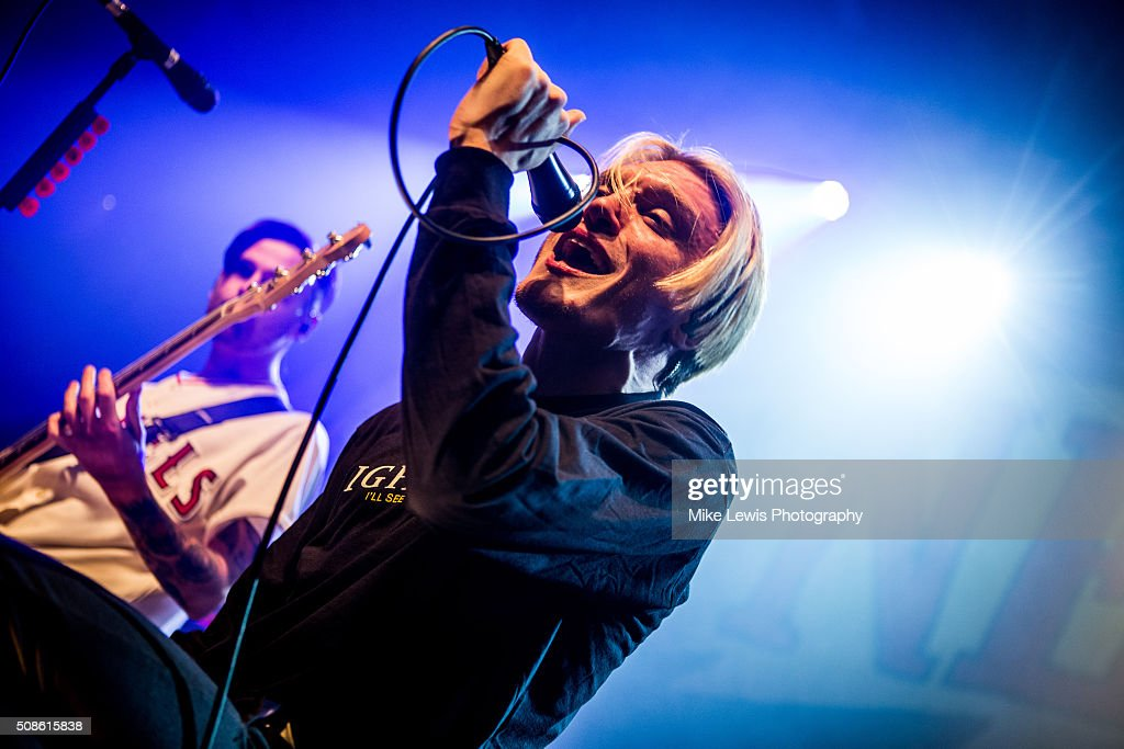 Ben Barlow of Neck Deep performs on stage at Cardiff University on February 5, 2016 in Cardiff, Wales.