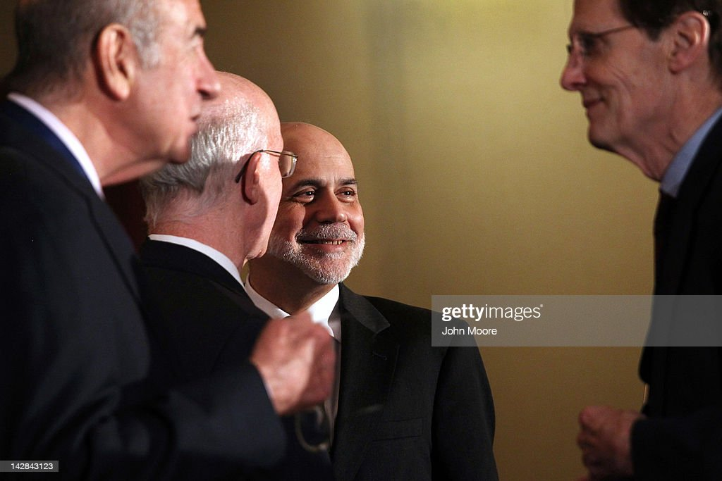 <a gi-track='captionPersonalityLinkClicked' href=/galleries/search?phrase=Ben+Bernanke&family=editorial&specificpeople=568098 ng-click='$event.stopPropagation()'>Ben Bernanke</a> (C), Chairman of the Board of Governors of the Federal Reserve System, prepares to speak on April 13, 2012 in New York City. The Fed chairman gave the keynote address at the 'Rethinking Finance: New Perspectives on the Crisis' conference held by the Russell Sage Foundation and the Century Foundation at the Princeton Club of New York.