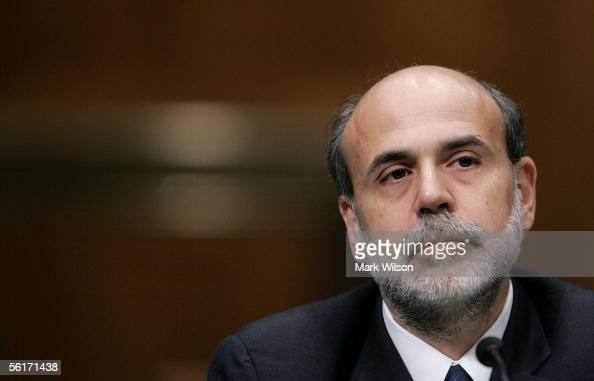 Ben Bernanke US President George W Bush's nominee to be Chairman of the Board of Governors of the Federal Reserve System listens as Senators make...
