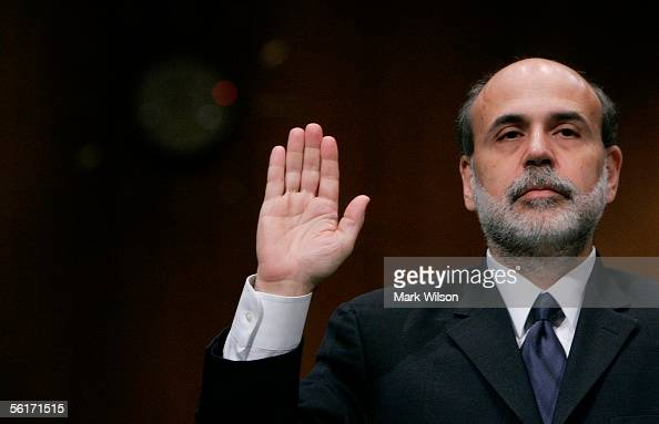 Ben Bernanke US President George W Bush's nominee to be Chairman of the Board of Governors of the Federal Reserve System is sworn in during his...