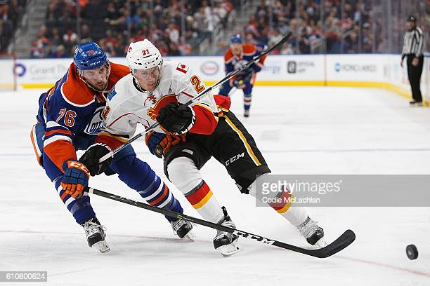 Ben Betker of the Edmonton Oilers skates against Lauri Korpikoski of the Calgary Flames on September 26 2016 at Rogers Place in Edmonton Alberta...