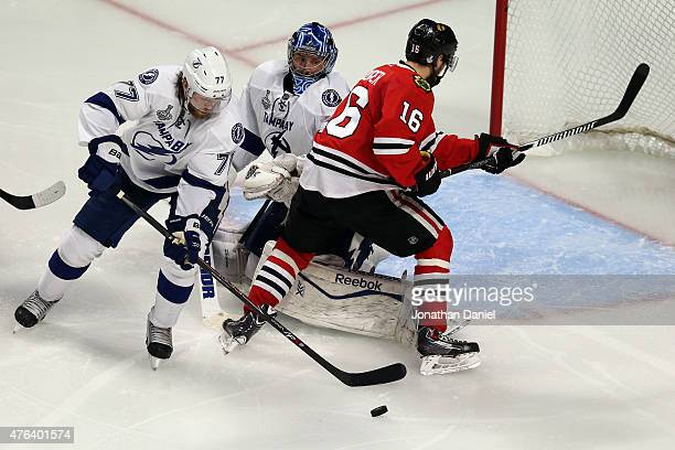 Ben Bishop and Victor Hedman of the Tampa Bay Lightning defend against Marcus Kruger of the Chicago Blackhawks during Game Three of the 2015 NHL...