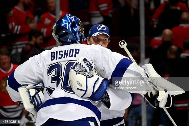 Ben Bishop celebrates with Andrei Vasilevskiy of the Tampa Bay Lightning after defeating the Chicago Blackhawks 32 in Game Three of the 2015 NHL...