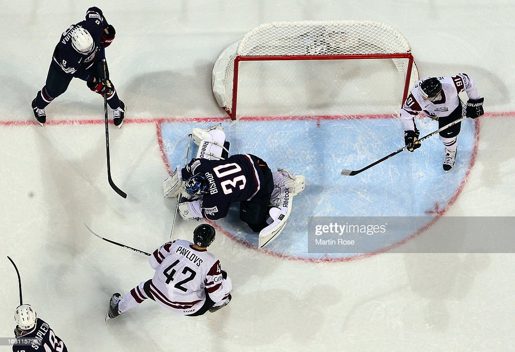 <a gi-track='captionPersonalityLinkClicked' href=/galleries/search?phrase=Ben+Bishop&family=editorial&specificpeople=700137 ng-click='$event.stopPropagation()'>Ben Bishop</a>, goaltender of USA covers the puck during the IIHF World Championship group H match between Latvia and USA at Hartwall Areena on May 5, 2013 in Helsinki, Finland.