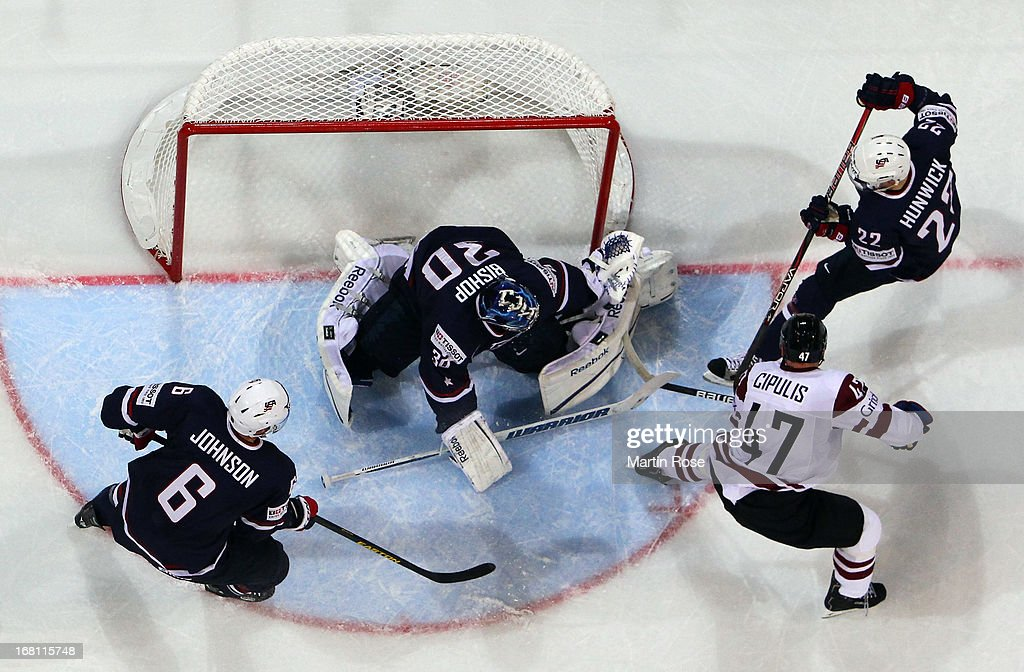 <a gi-track='captionPersonalityLinkClicked' href=/galleries/search?phrase=Ben+Bishop&family=editorial&specificpeople=700137 ng-click='$event.stopPropagation()'>Ben Bishop</a>, goaltender of USA makes a save on Martins Cipulis (#47) of Latvia during the IIHF World Championship group H match between Latvia and USA at Hartwall Areena on May 5, 2013 in Helsinki, Finland.