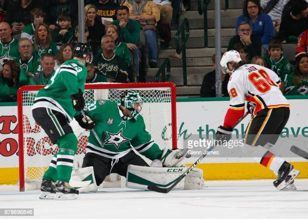 Ben Bishop of the Dallas Stars makes a save against Jaromir Jagr of the Calgary Flames at the American Airlines Center on November 24 2017 in Dallas...