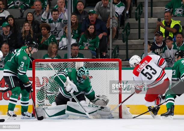 Ben Bishop of the Dallas Stars makes a save against Jeff Skinner of the Carolina Hurricanes at the American Airlines Center on October 21 2017 in...