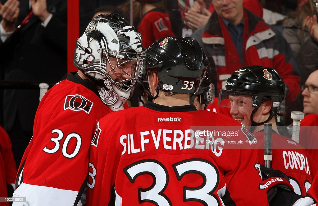 Ben Bishop #30 of the Ottawa Senators celebrates with team mate Jakob Silfverberg #33 following their win against the New York Rangers, in an NHL game at Scotiabank Place on February 21, 2013 in Ottawa, Ontario, Canada.