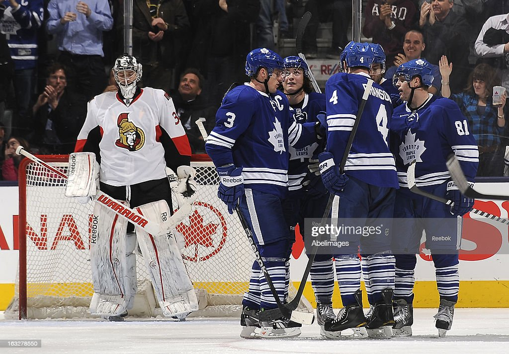 <a gi-track='captionPersonalityLinkClicked' href=/galleries/search?phrase=Ben+Bishop&family=editorial&specificpeople=700137 ng-click='$event.stopPropagation()'>Ben Bishop</a> #30 of the Ottawa Senators looks on as <a gi-track='captionPersonalityLinkClicked' href=/galleries/search?phrase=Phil+Kessel&family=editorial&specificpeople=537794 ng-click='$event.stopPropagation()'>Phil Kessel</a> #81 of the Toronto Maple Leafs celebrates a third period goal with teammates during NHL game action March 6, 2013 at the Air Canada Centre in Toronto, Ontario, Canada.