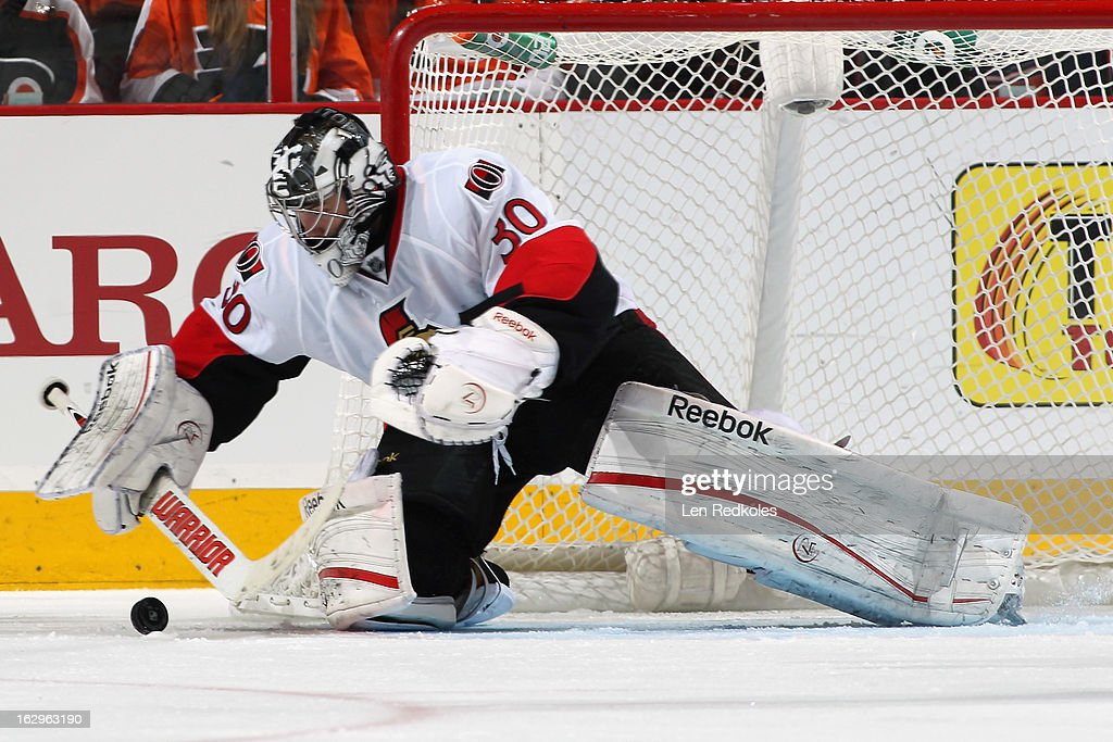 Ben Bishop #30 of the Ottawa Senators lunges to stop the loose puck against the Philadelphia Flyers on March 2, 2013 at the Wells Fargo Center in Philadelphia, Pennsylvania.